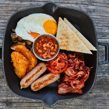 Egg, beans, bread, hot dog and other breakfast item